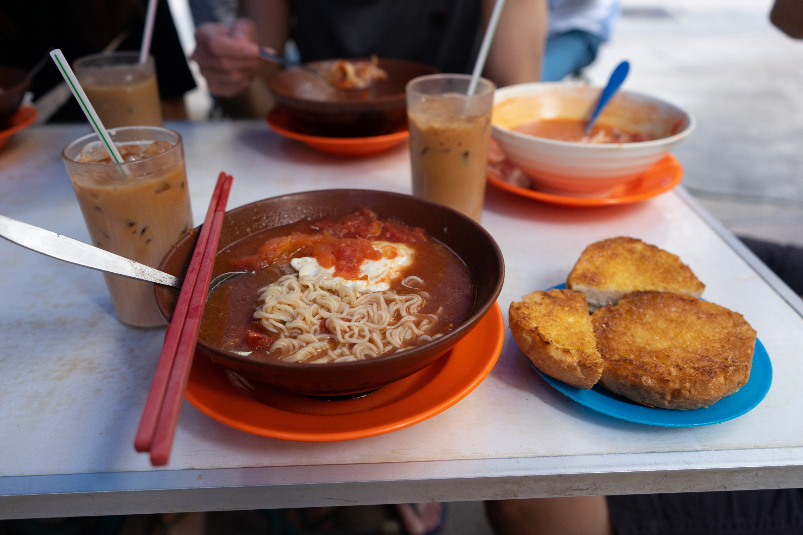 Full meal with tomato broth soup and condensed milk buns at Sin Heung Yuen, one of the best local foods in Sheung Wan Hong Kong