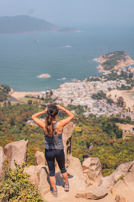 A girl looking at the view from Dragon's Back in Hong Kong